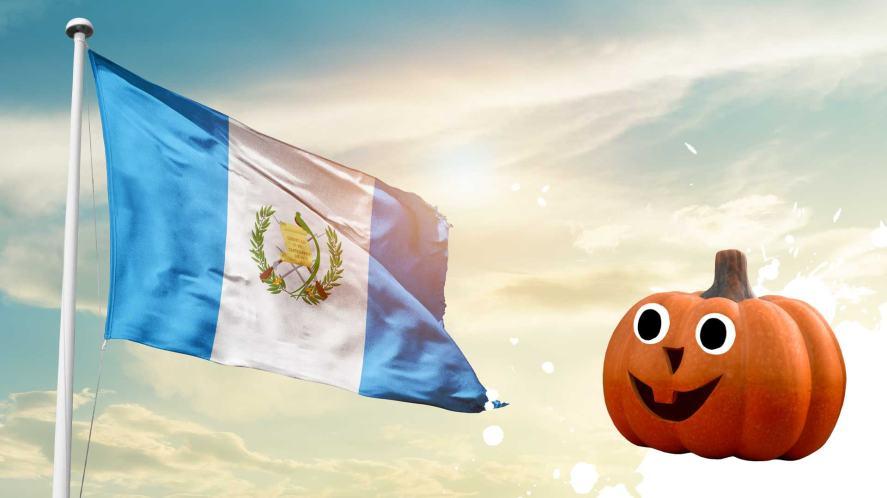 A Guatemalan flag and a happy pumpkin