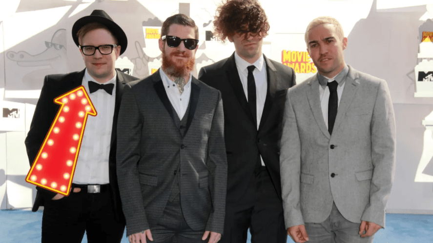 Fall Out Boy with their singer Patrick Stump highlighted with a fancy arrow