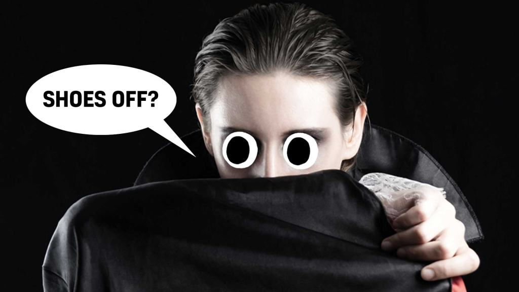A vampire hiding behind a cape