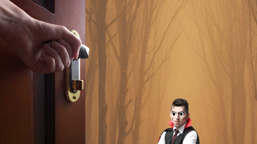 A small vampire waits at an open door