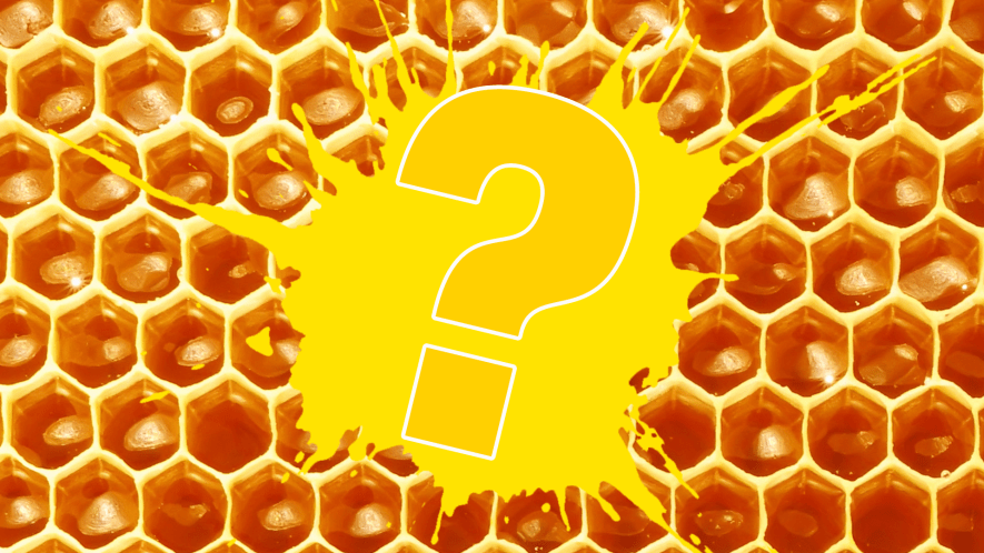Question mark on yellow splat and honeycomb background