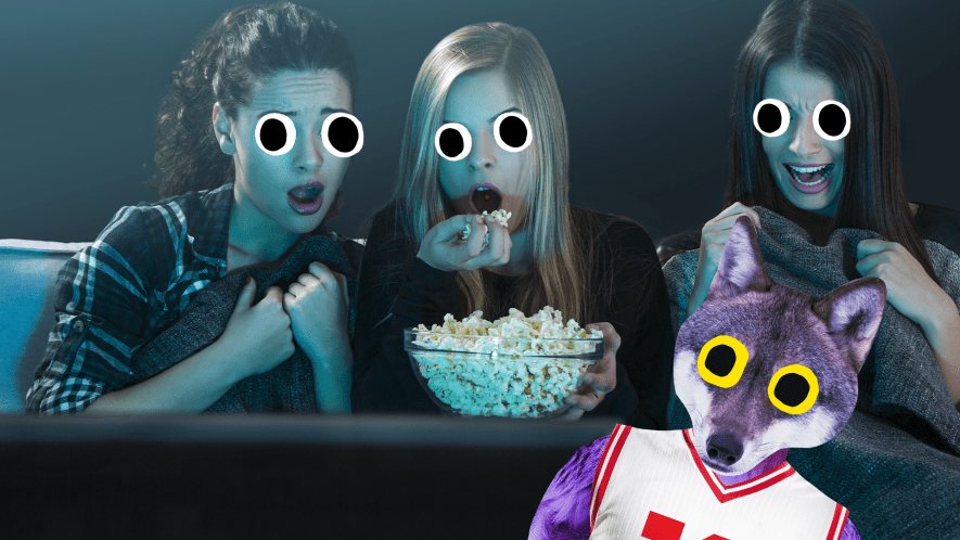 Three women watching a film looking scared with Beano werewolf