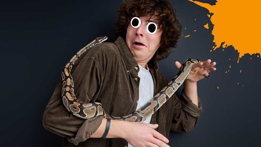 Man with snake looking scared on dark background with orange splat