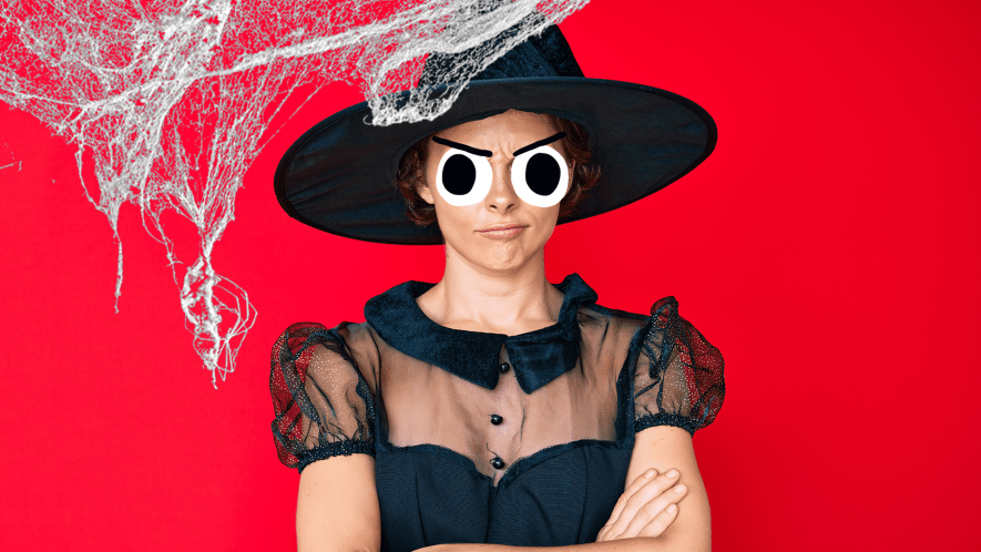 Grumpy looking witch on red background with cobwebs