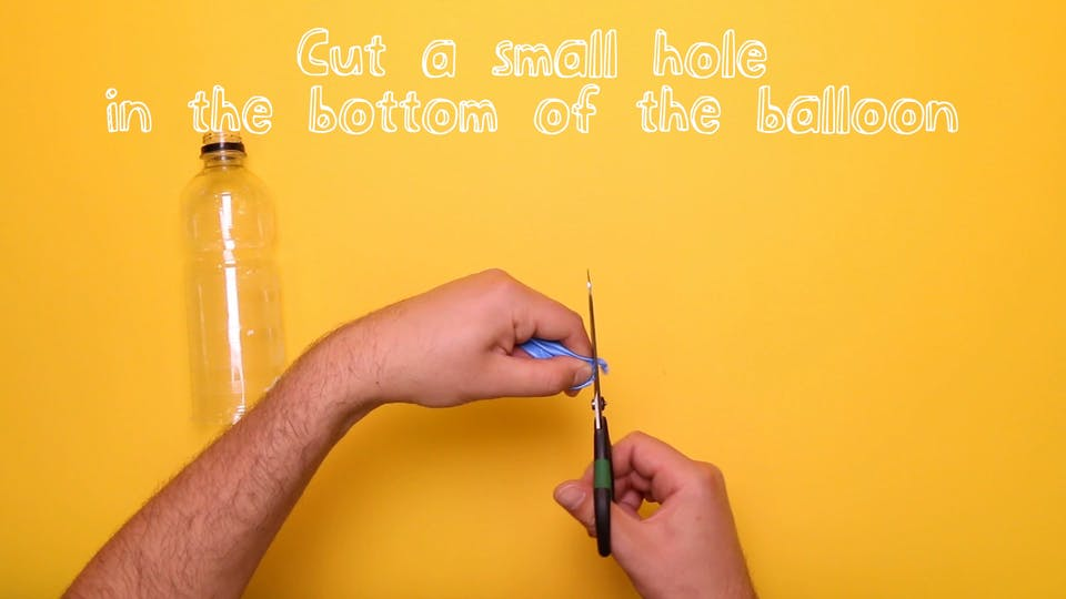 Cut a hole in the end of the balloon