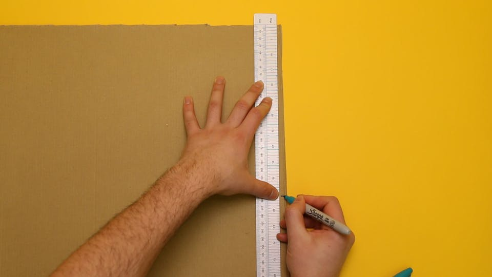 Measure the length of the tube and mark the cardboard