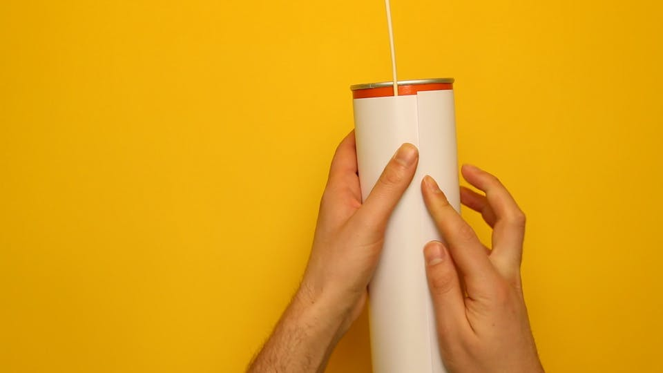 Wrap a sheet of paper around the tube and tape it to hold it in place