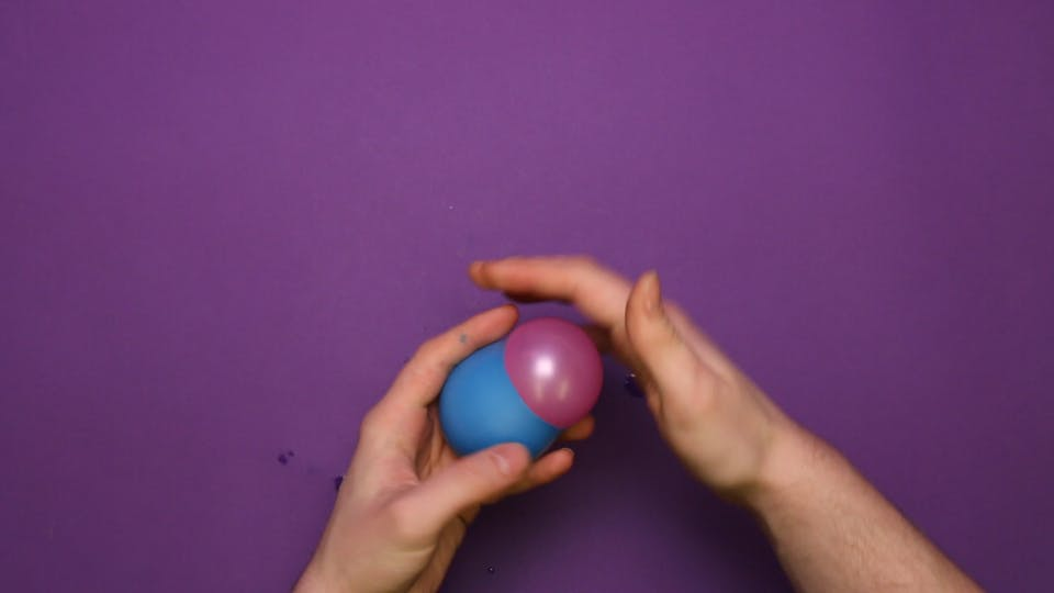 Cut the end off a new balloon, and squeeze the balloon in again