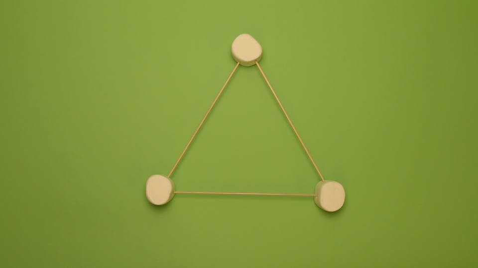 Stick each skewer between 2 marshmallows to make a triangle