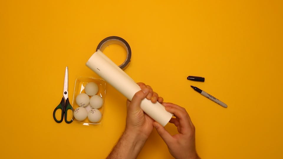 Use your A4 sheet of card to make a tube for the barrel of your cannon.