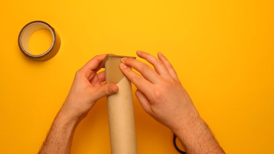 Use tape to securely attach the end of the kitchen roll tube