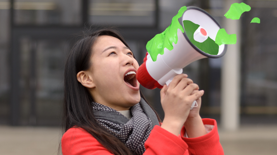 Which slime are you? Woman shouting into a slime filled megaphone