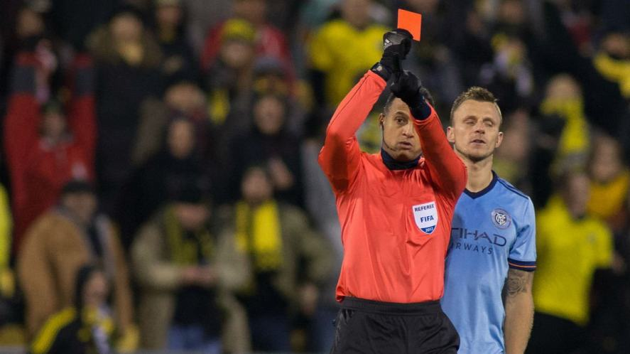 The referee shows the red card