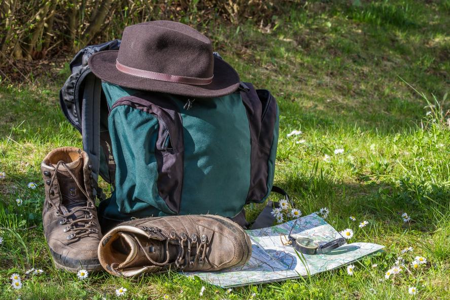 A backpack, hiking boots and a map