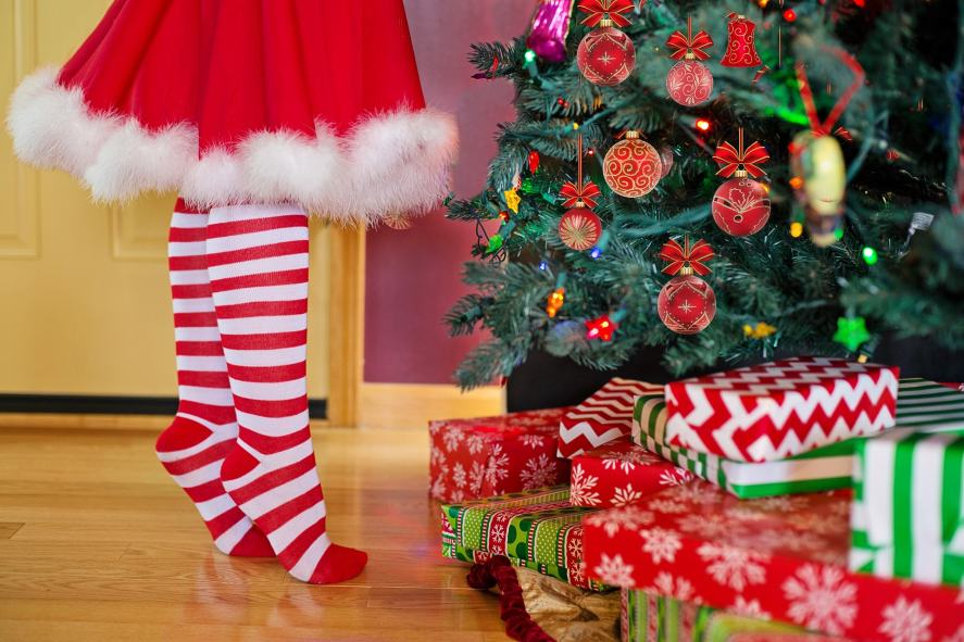Christmas Song Quiz - Christmas legs by the tree