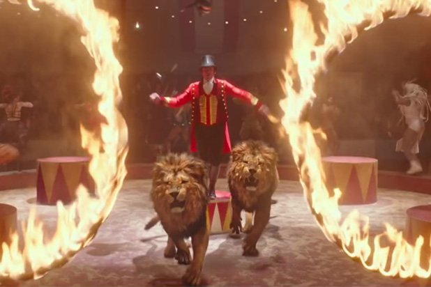 Hugh Jackman performs with two lions in a scene from The Greatest Showman