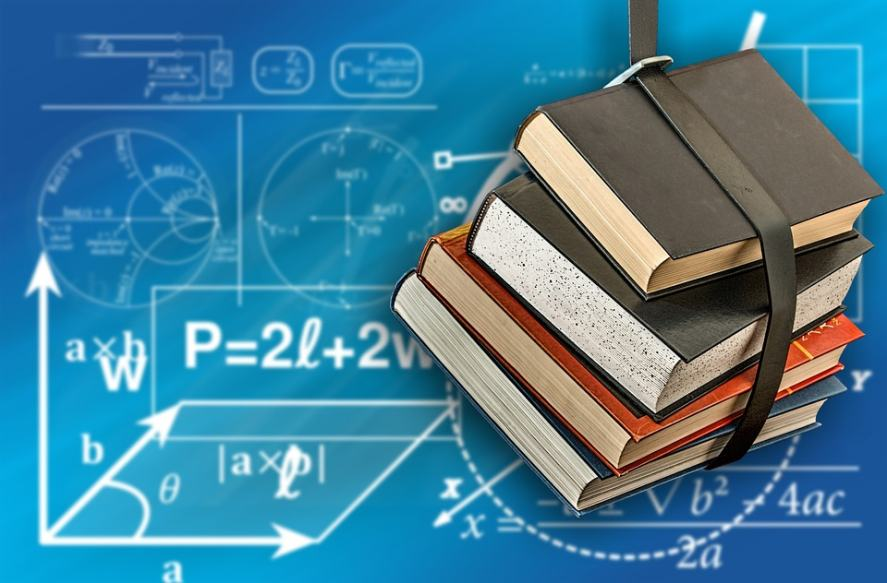 An image of school books and maths equations