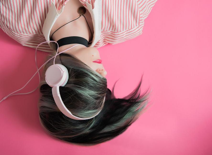 Someone listening to music on headphones