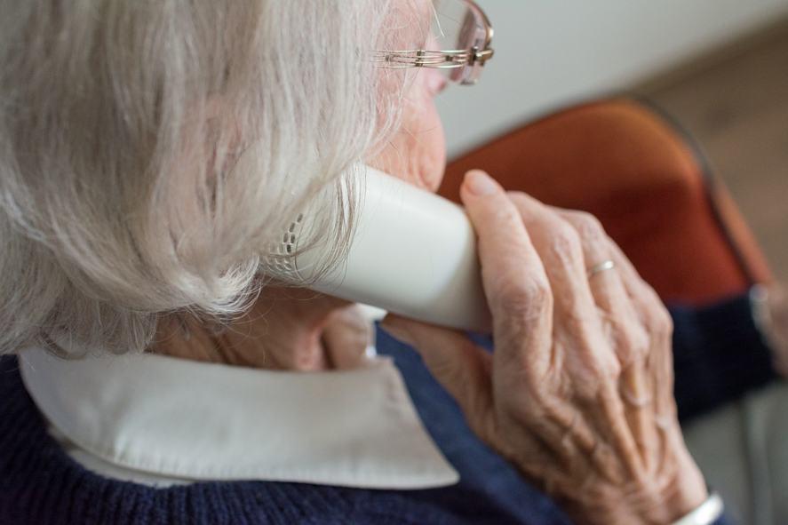 An elderly woman makes a prank call