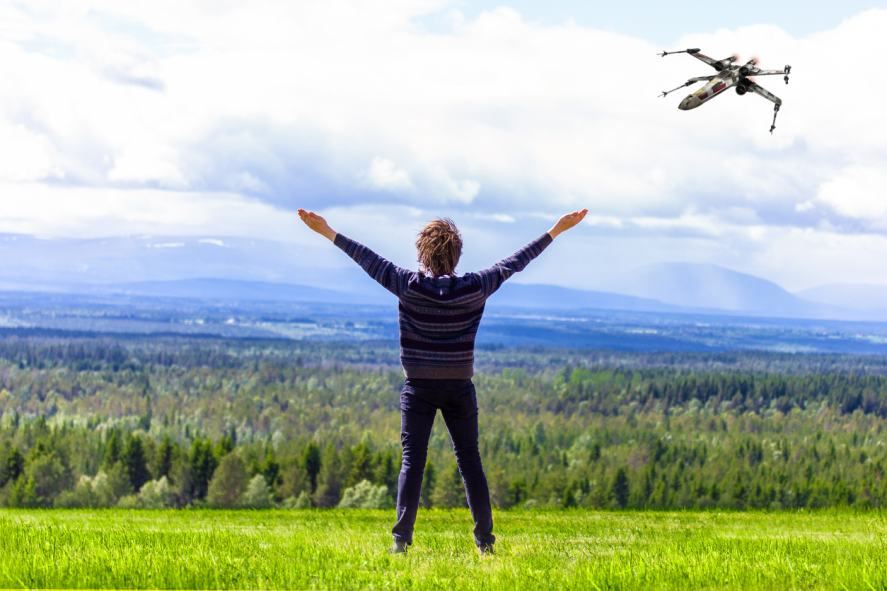 A relaxed person standing on a windy hill