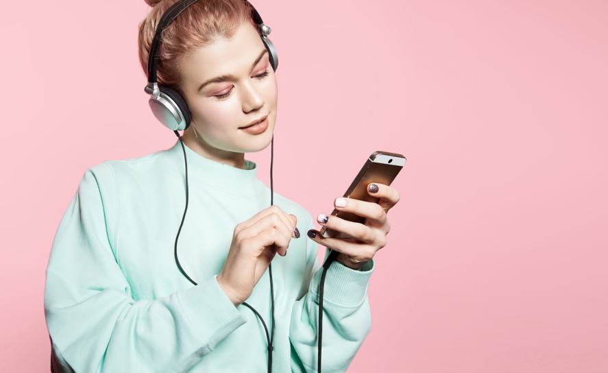 A woman listening to music on a pair of headphones