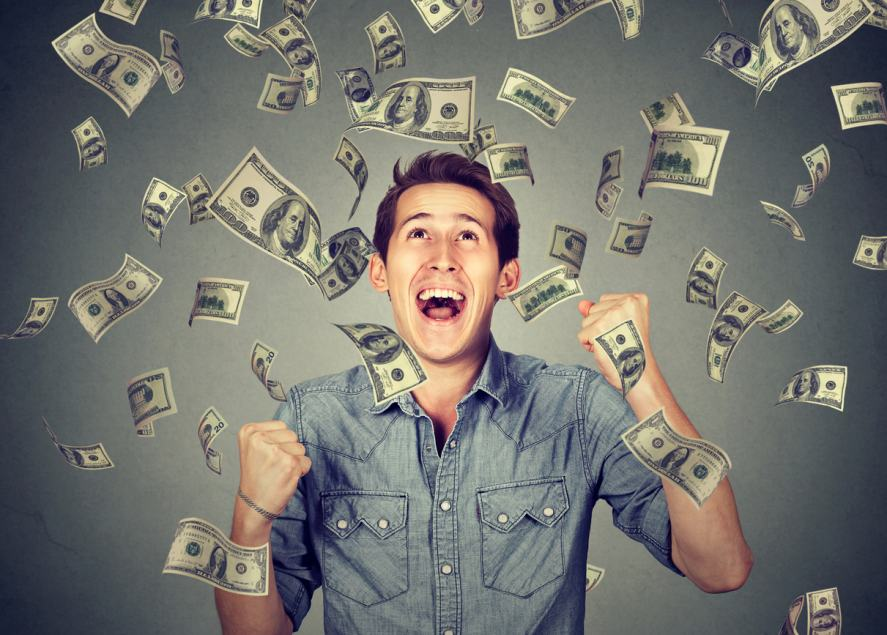 A man being showered with lots of money
