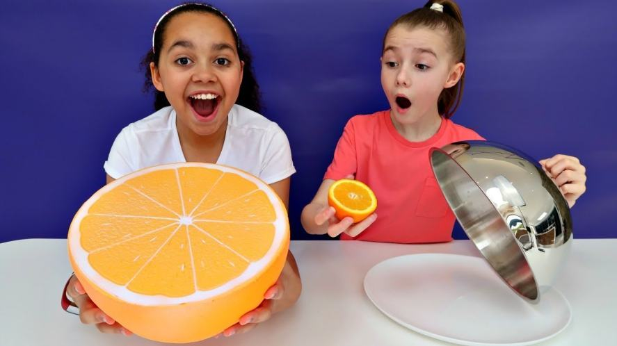 Tiana with a giant orange