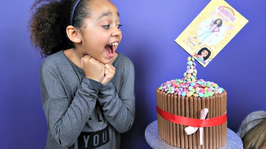 Tiana with a cake