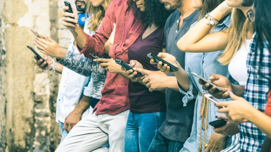 A group of people using their mobile phones