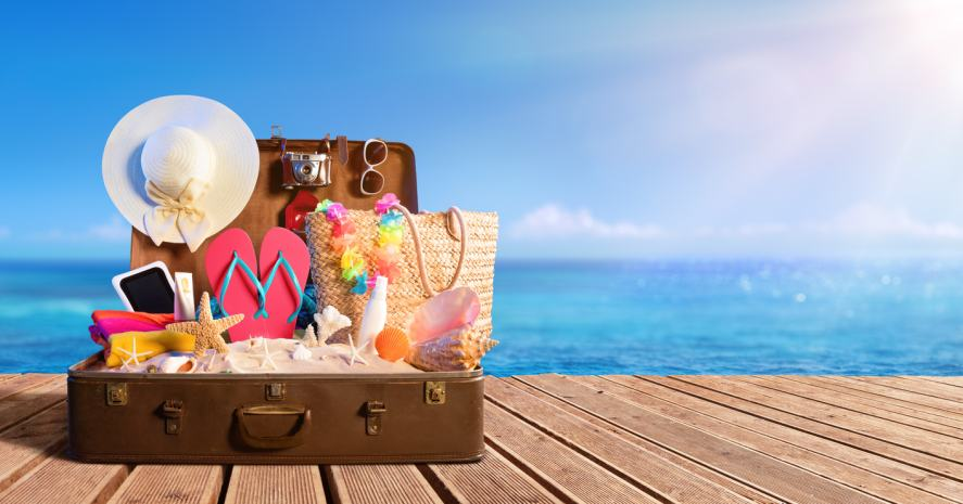 A suitcase packed for a sunny holiday