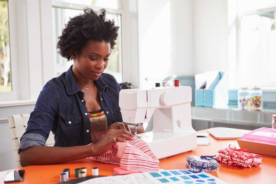 A woman makes clothes on a sewing machine