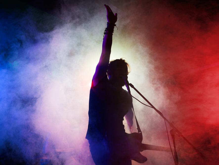 A silhouette of a pop star in concert