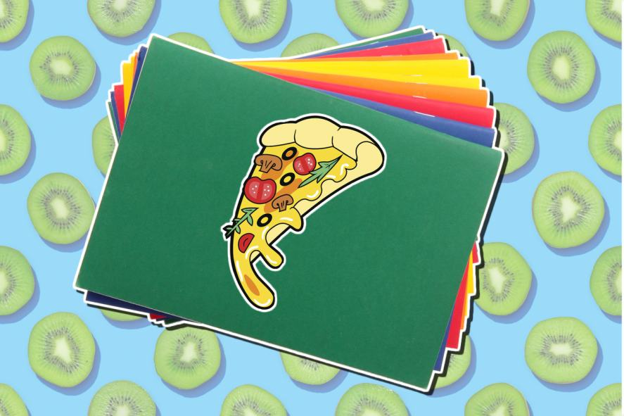 A pizza slice sticker on a school book
