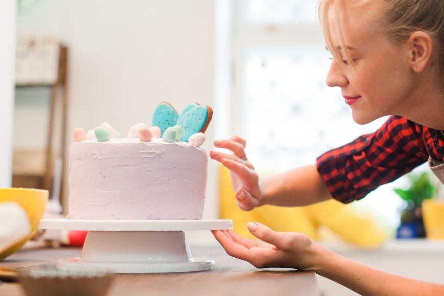 Woman decorates homemade cake