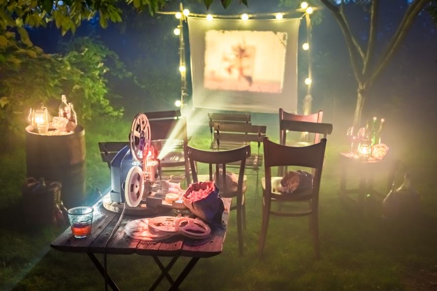 A home cinema in a candlelit garden
