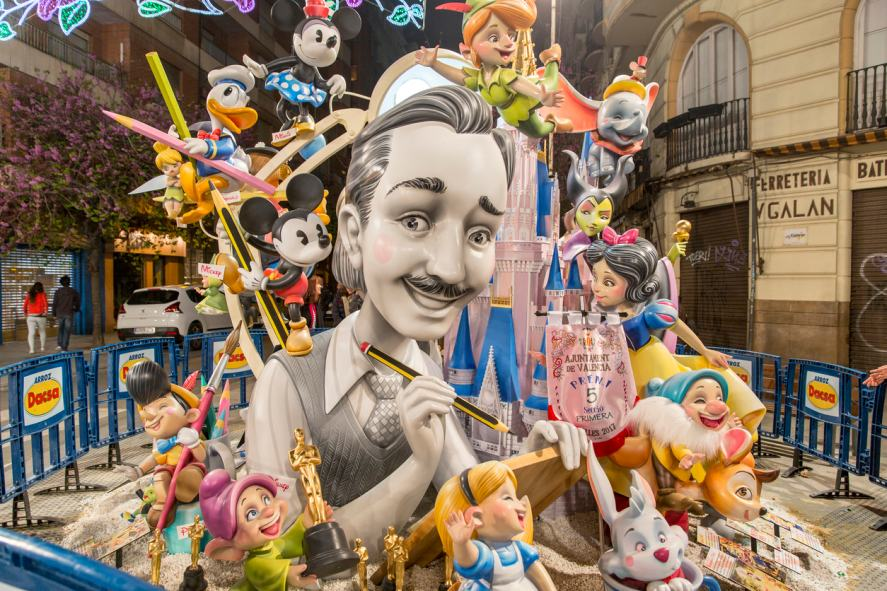 A statue of Walt Disney and his characters