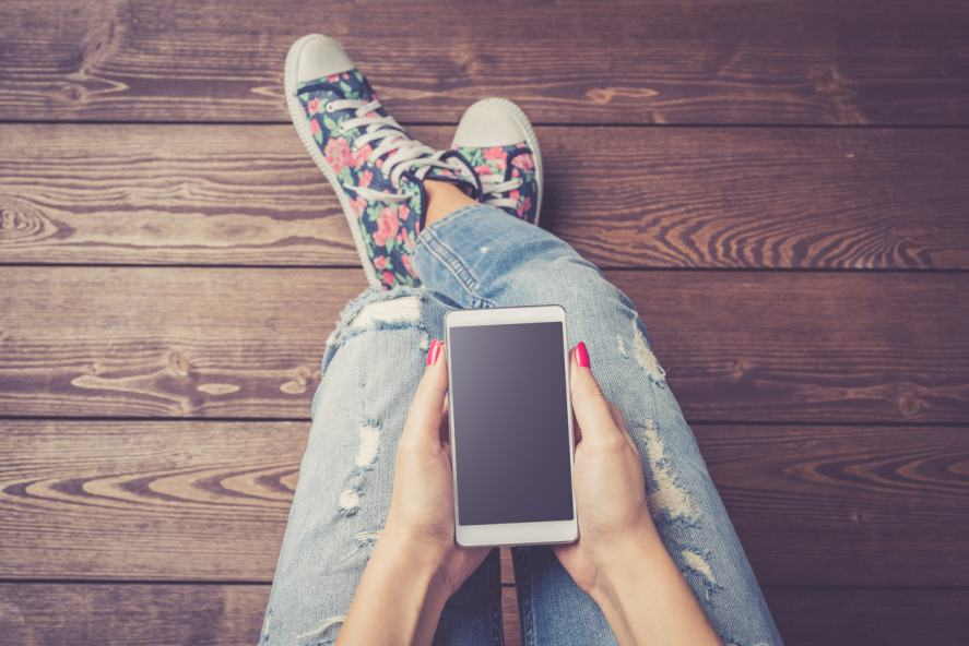 A woman holding a smartphone