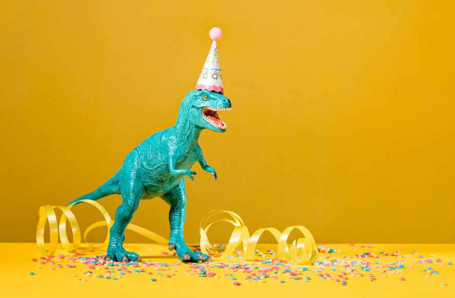 A dinosaur getting into the party spirit