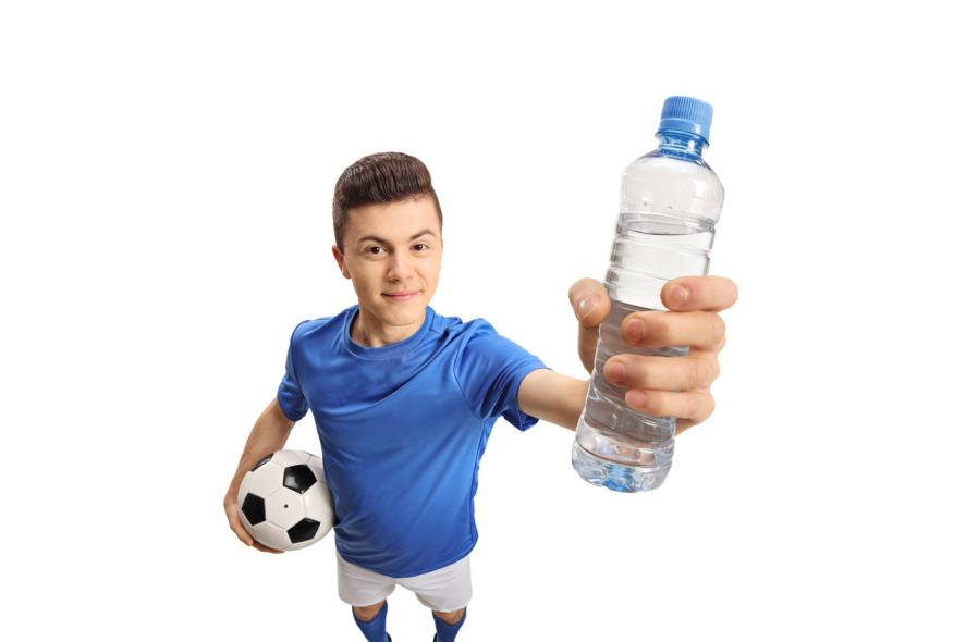A football player drinks a bottle of water