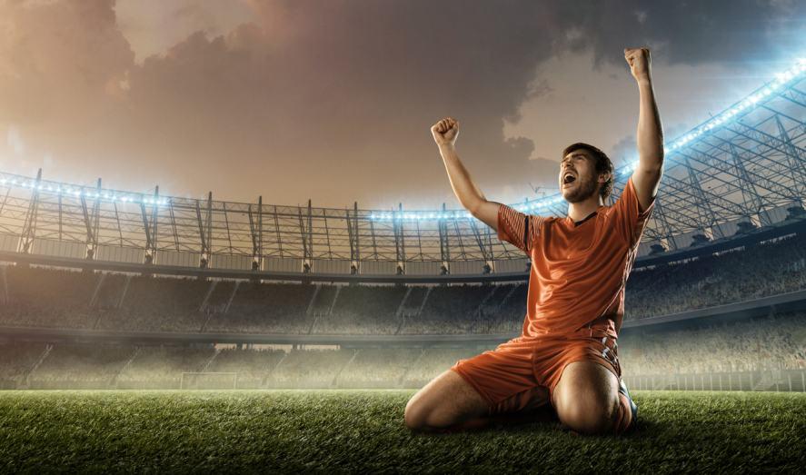 A football player celebrates the winning goal