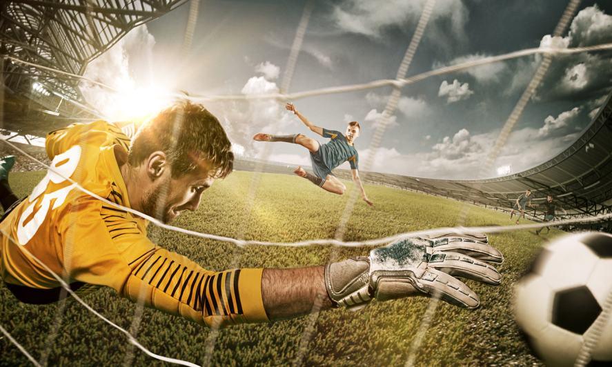 A footballer scores a goal