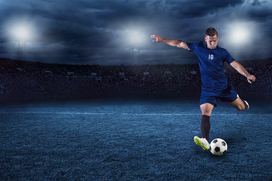 A footballer takes a penalty