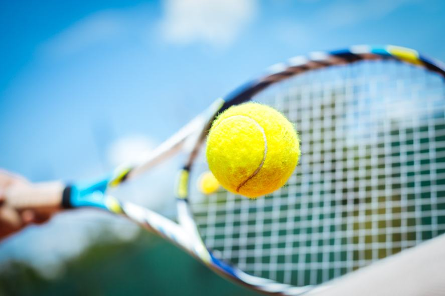 A tennis racquet striking the ball