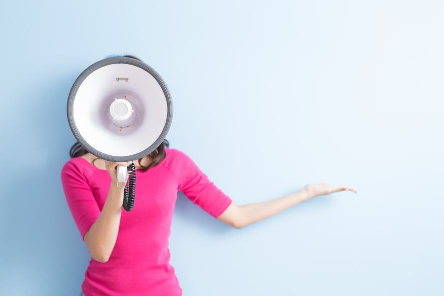 A woman holding a megaphone