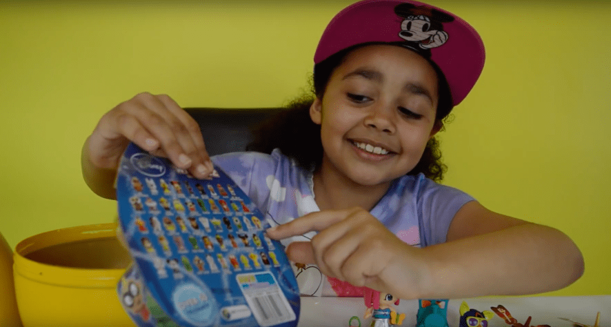Tiana opens a massive egg full of toys