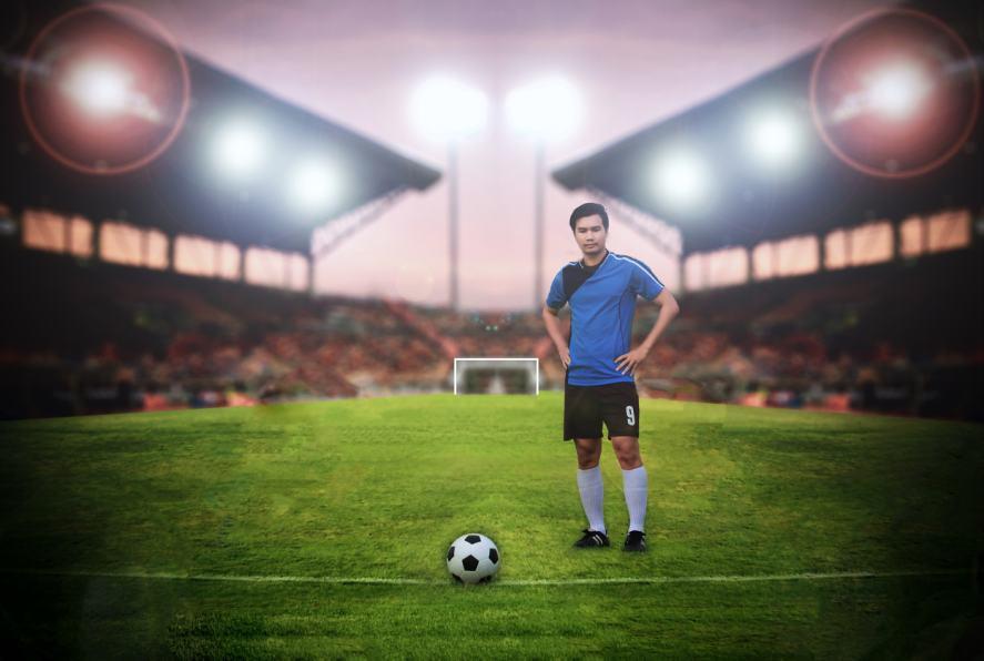A footballer prepares to take a penalty