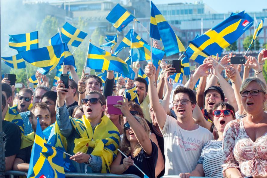 Swedish football fans cheer on their team