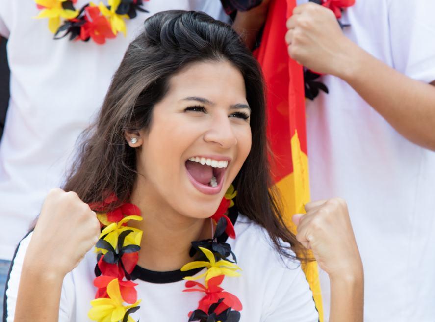 A happy German soccer fan at stadium