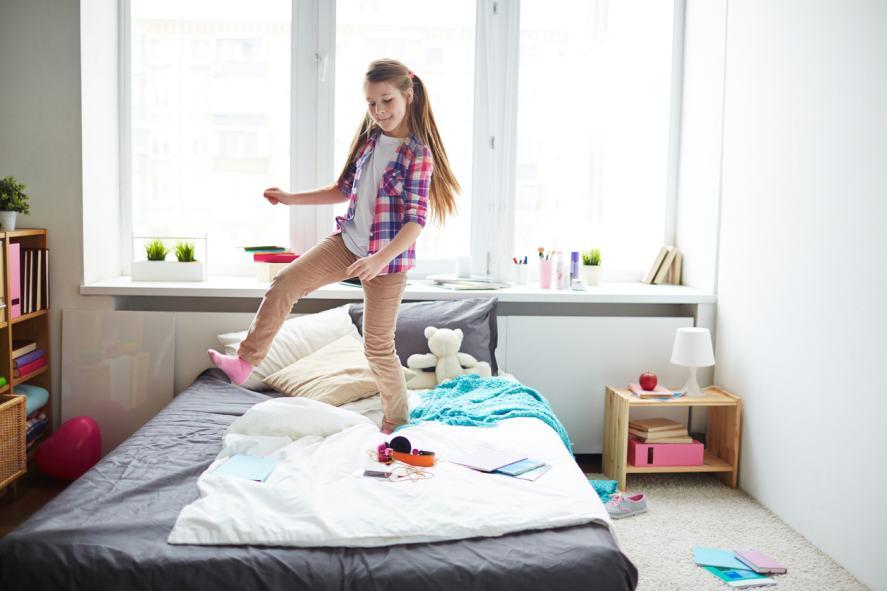 Girl dancing on bed