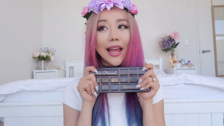 Wengie  quiz: she holds up some cosmetics